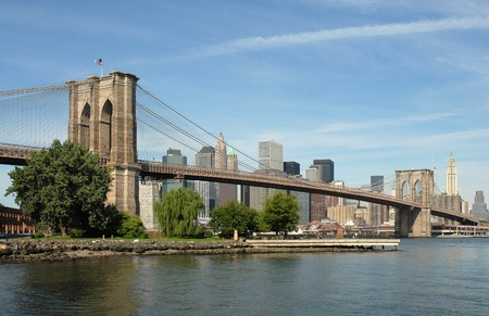 manhattan bridge: Picture of the iconic Brooklyn Bridge in New York City, taken from the Brooklyn shoreline looking across towards Manhattan Stock Photo