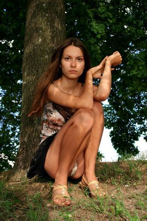 The sexual girl under a tree Stock Photo - 270094