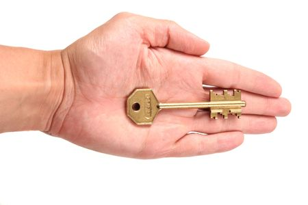 Outstretched palm holding a house key Stock Photo - 280407