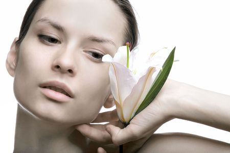 Portrait of the girl holding in a hand a flower a lily Stock Photo