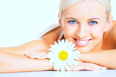 A smiling girl with a flower a camomile Stock Photo