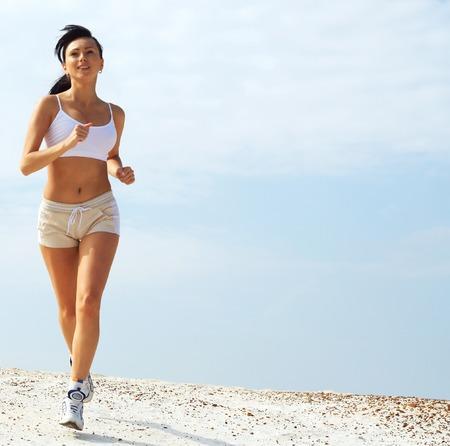 girl runs on sand Stock Photo - 1629363