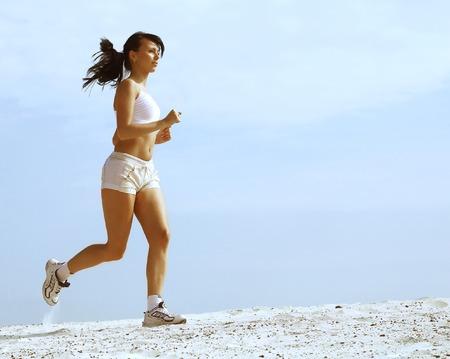 girl runs on sand Stock Photo - 1629371