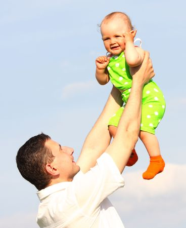 kinship: small daughter on hands of the father