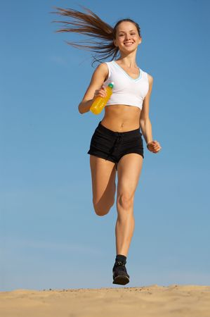 girl runs on sand