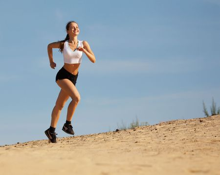 the runs: girl runs on sand