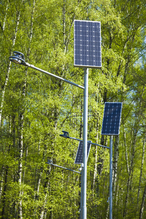 solar array: solar battery powers an electric lamp in the park