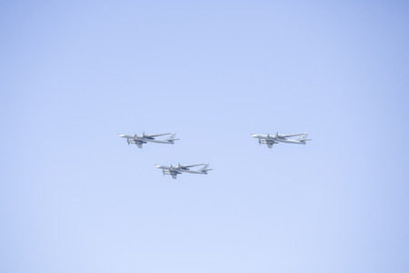 Ceremonial flight aviation in the sky over Moscow. A group of military aircraft in the air