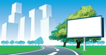 Blank billboard and roadside trees at the road, cityscape in the background. photo