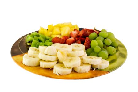 Fruit plate with bananas,strawberries,kiwis and pineapple photo