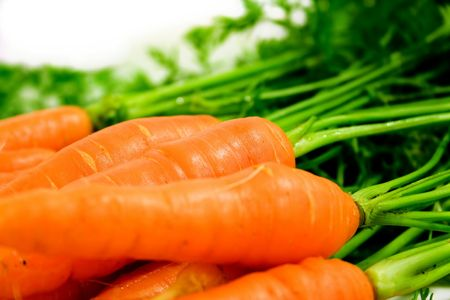farmed: Buch of carrots isolated on white background
