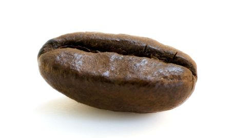 caf: Macro shot of a single coffee bean isolated on white background