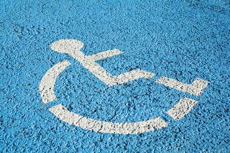 reserved seat: Blue handicap parking or wheelchair accessible sign in parking  Stock Photo