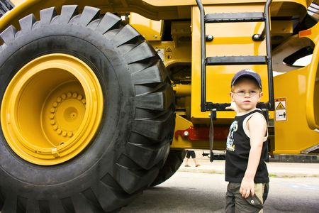 Little boy ready to work on a construction truck  photo