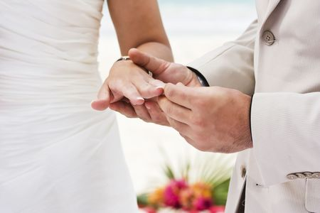 Groom giving an engagement ring to his bride Stock Photo - 5586095