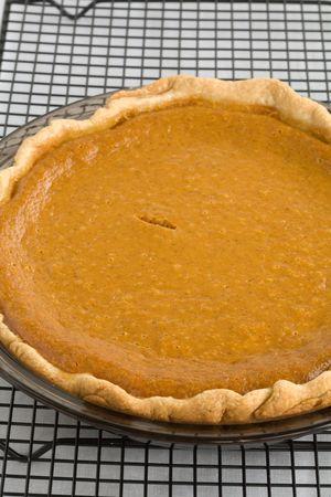 Fresh Baked Pumpkin Pie on a cooling rack photo