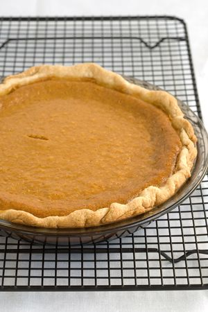 Fresh Baked Pumpkin Pie on a cooling rack photo