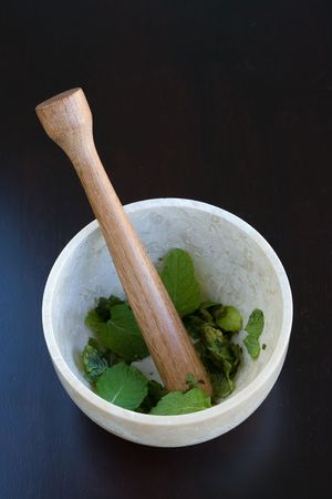 Muddling Mint in a marble morter photo