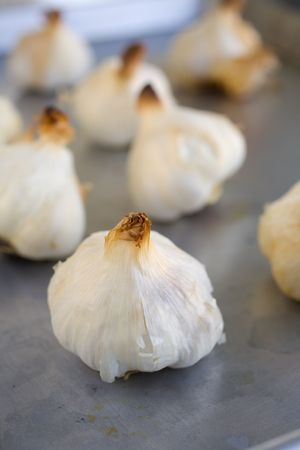 Bulbs of Roasted Garlic on a roasting pan fresh out of the oven Stock Photo - 795654