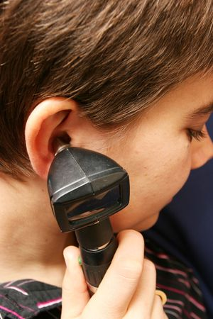 Medical equipment being used to check womans hearing photo