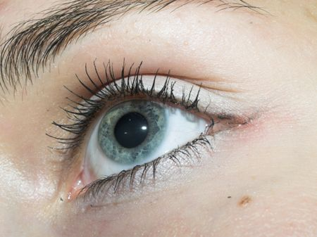 widely: Beautiful widely open an eye, with a blue iris of the eye.