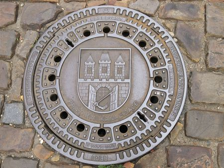 Manhole cover in Prague photo