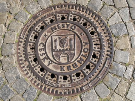 Manhole cover in the Czech Krumlov photo