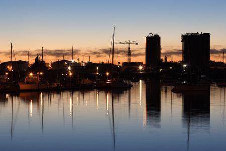 Photo showing the tankfarm and Westhaven Marina at sunrise photo