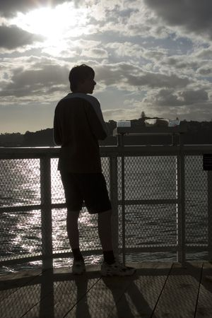 Photo of young boy fishing on a wharf Stock Photo - 293478