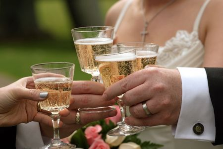 Hands holding champagne glasses  photo