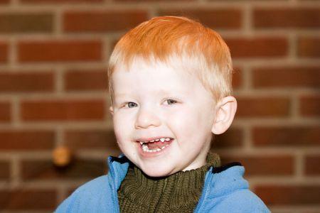 joyfull: Little boy smiling and laughing