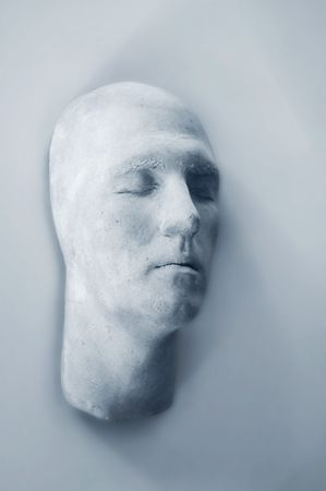 desolation: Plaster Face on Wall - Abstract