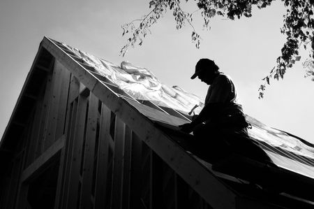 asphalt shingles: contractor on roof - silhouette