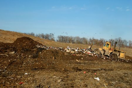 bulldozer at garbage dump Stock Photo