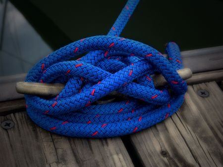 rope tied to dock securing boat