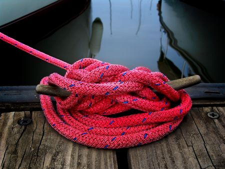 water anchor: red boaters rope securing boat to dock