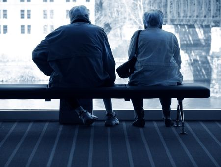 elderly couple sitting together photo