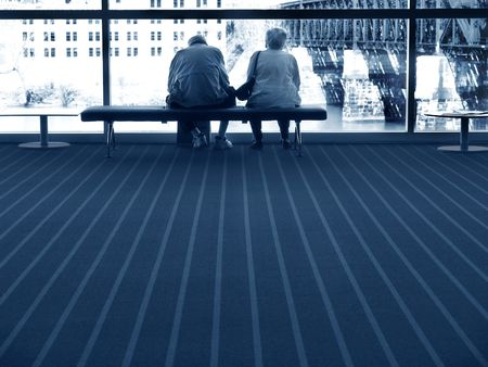 mature couple sitting on bench together Stock Photo