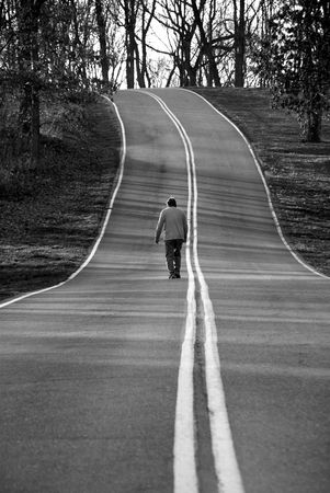 dreary: man walking on a country road Stock Photo