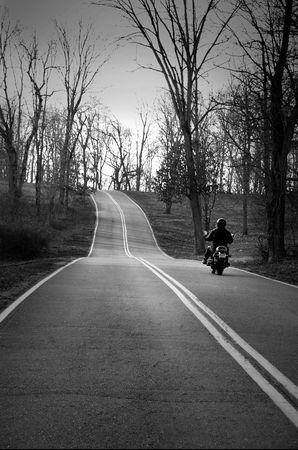 man on bike riding through country winter Stock Photo