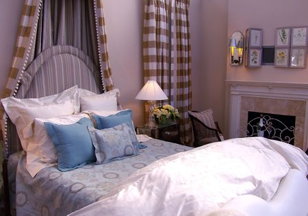 bedroom - bed with headboard in front of fireplace