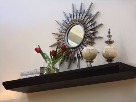 interior wall design decorated with mirror books and roses