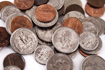 spare change - US coins on white background Stock Photo
