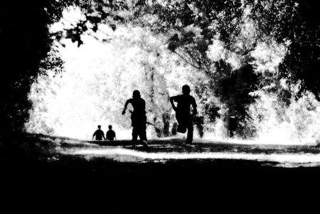 children running up a hill