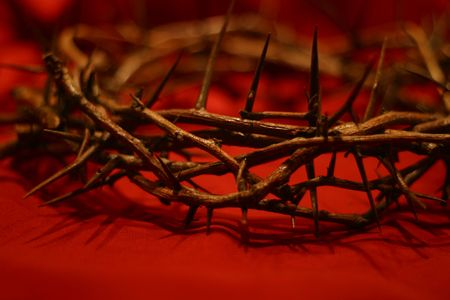 redemption: crown of thorns against red background symbolic the day He wore our crown