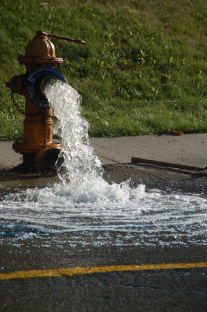 fire hydrant releasing water Stock Photo