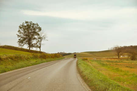 amish buggy: Amish carriage riding on country road in Ohio Stock Photo