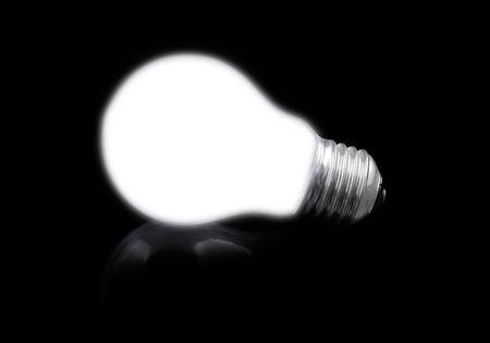 close-up of lit light bulb on black Stock Photo - 795504