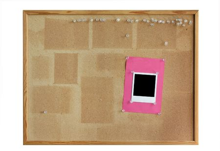 thumbtacked: cork board with empty photo frame isolated on white background