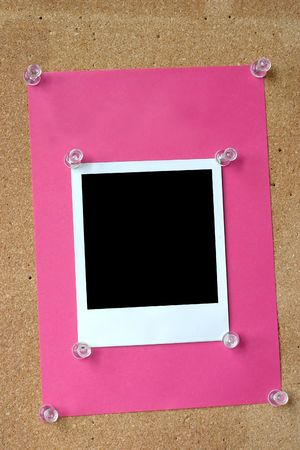 close-up of photo frame thumbtacked to cork board photo